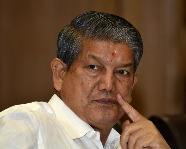 Uttarakhand CM summoned by CBI after being seen in a sting operation