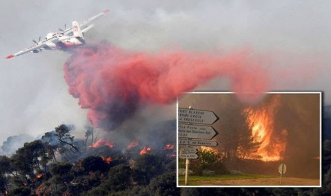 Wildfire erupts in France, scores flee across